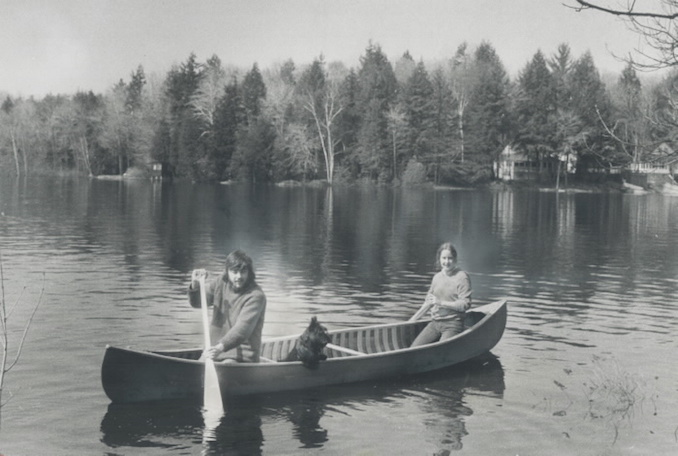 1972 - Diane Walker and Dermot McCarthy of Hamilton enjoy a peaceful paddle on Lake Muskoka. Thousands of cottagers will start heading north tonight for the first long weekend of the summer season