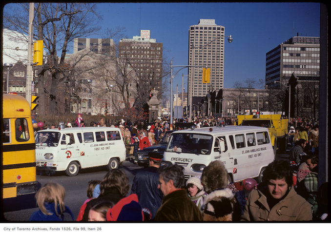 1974 - Nov 16 - St. John's Ambulance and crowd at Avenue and Bloor - Santa Claus Parade