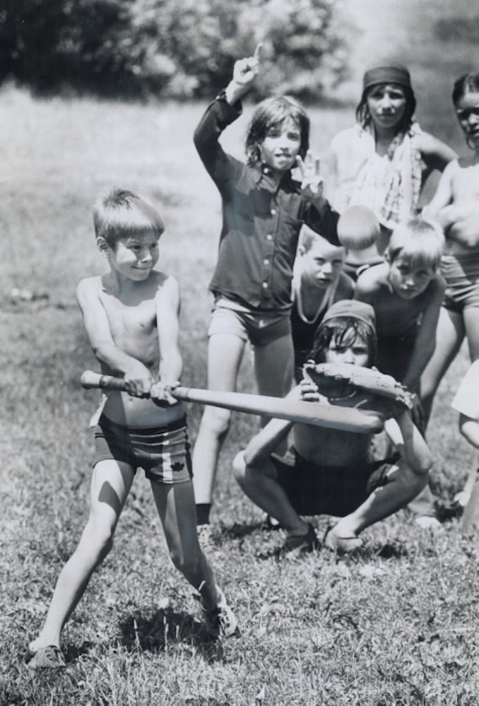 1975 - Regent Park Summer Day Camp's open spaces are just perfect for informal baseball games. The camp; which is the Greenwood Conservation area; is assisted by the Fresh Air Fund
