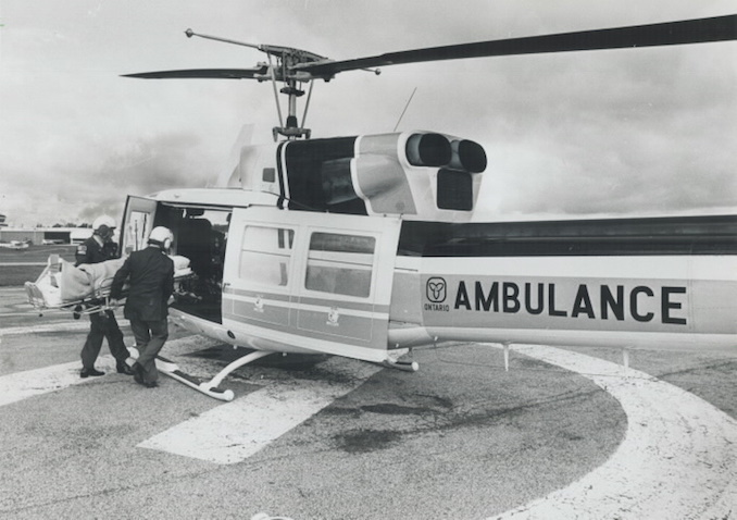 1977 - Colin McConnell - Emergency patient is loaded onto a government ambulance for transport to a Toronto hospital.