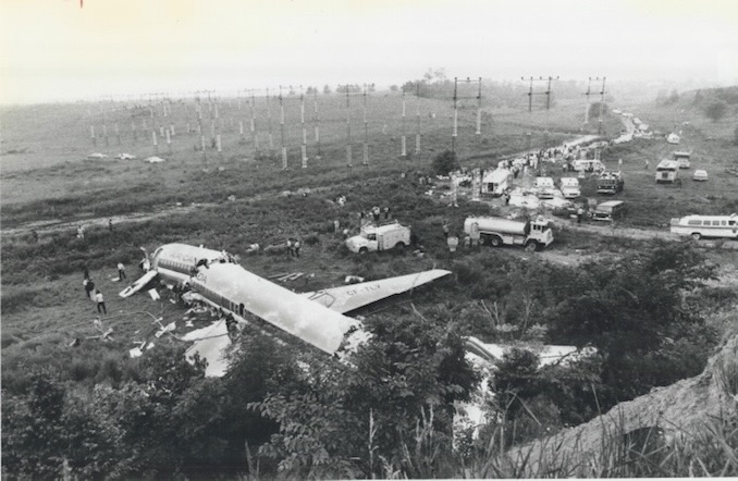 1978 - Graham Bezant - Fire trucks; ambulances; police cars and other emergency vehicles litter the Etobicoke Creek valley where the stricken plane came to rest. Cause of the crash has not been determined; an Air Canada official said
