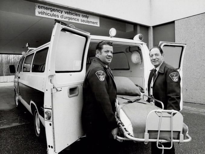 1980 - Ron Bull - Ambulance driver Henry Laurin (left) and attendant Ike Campbell, who spared no horses on the Adair mercy dash, making the 90 miles from Midland to Toronto's Hospital for Sick Children in 79 minutes