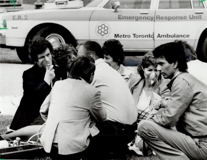 1985 - Don Dutton - Workers from a North York firm receive oxygen from ambulance attendants toxic gas was created when a worker mixed two chemicals; thinking them to be the same. The resulting gas infiltrated the ventilation system