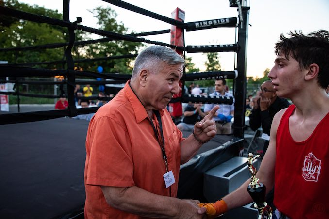 Boxing Legend, George Chuvalo gives amateur boxer, Tamas Glonczi of Sully's boxing gym some words of advice after his bout on Friday Night.