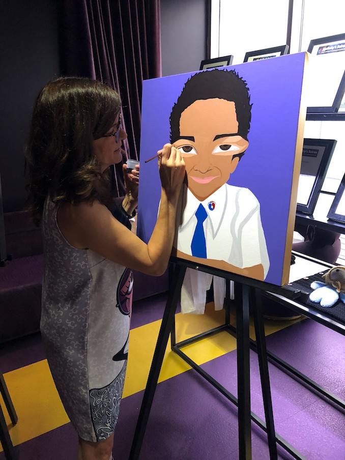 Michelle Vella painting a portrait of Malachy O'Reilly Wilks at Malachy's Soiree 2018 Charity Gala.