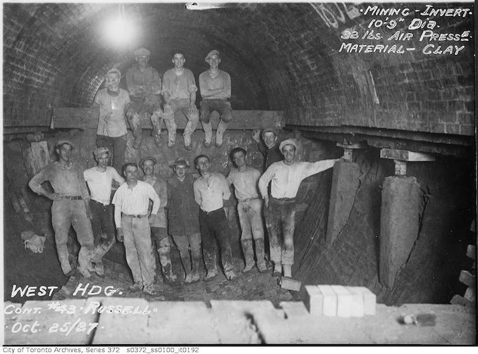 1927 - Sewer construction workers, west heading, contract 43 - Russell - mining invert, 10 feet, 9-inch diameter, 32 pounds air pressure, material clay