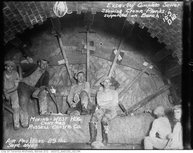 1927 - Sewers, excavation of complete sewer showing crown planks supported on bench, 10 foot 9 inch diameter - mining, west heading, contract 43, Russell Construction Company
