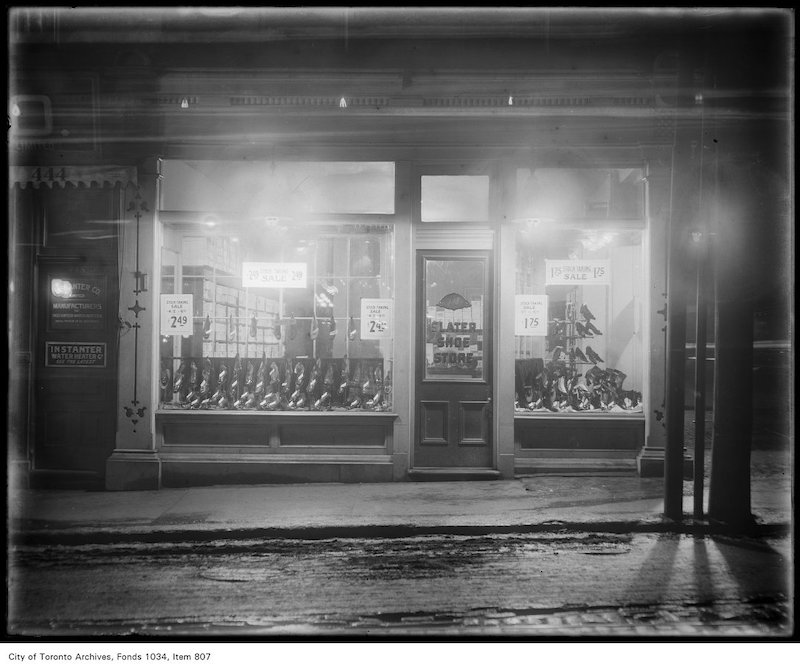 1900? - Window display of high-buttoned boots and shoes at Slater Shoe Store, 448 Yonge Street