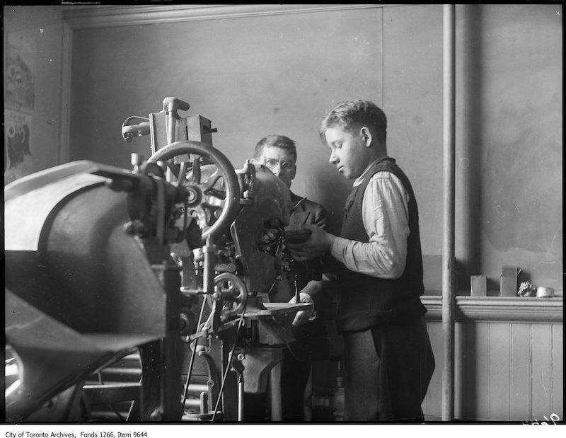 1926 - Jr Vocation School for boys, boy working shoe machine