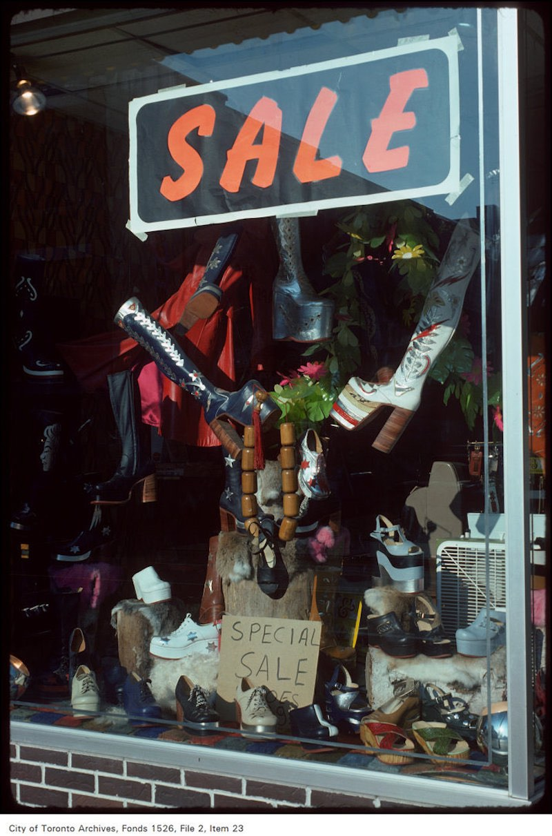 1975 - June 4 - View of shoe store window display on the west side of Yonge Street, north of Wellesly