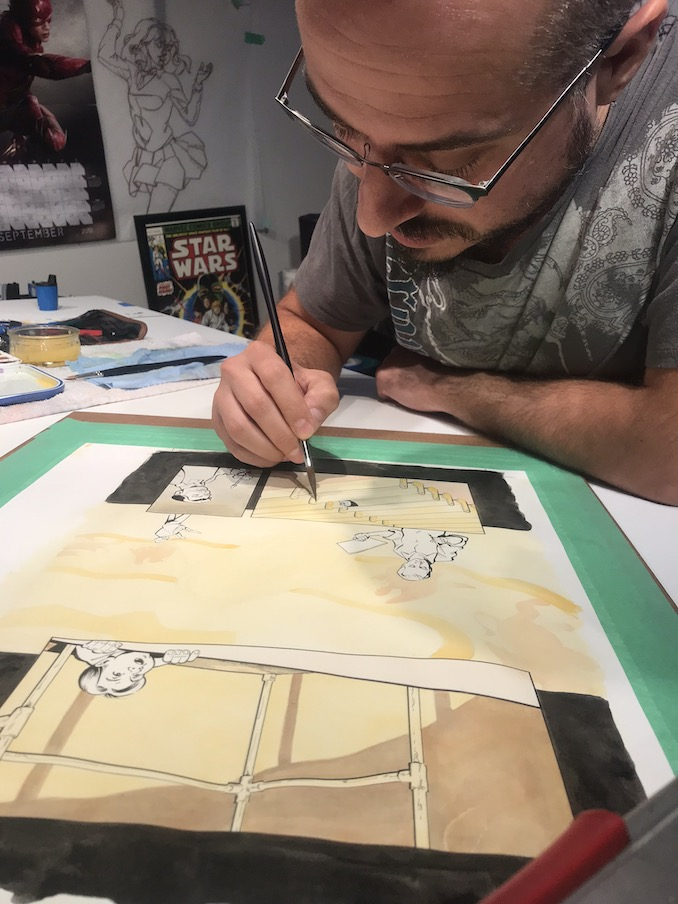 Nelson Caetano - Adding watercolour to one of the final pages of The Gathering Place.