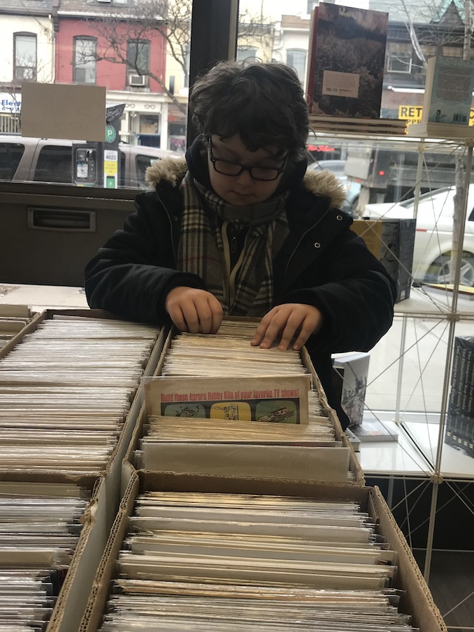 8. Flipping through old comics at our favourite hangout, The Beguiling, with my oldest son.