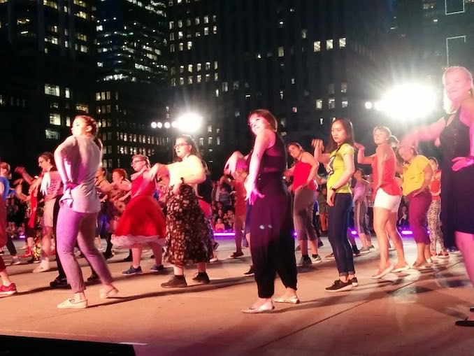A night-time performance of Sylvain Émard's Le Grand Continental at Toronto's Luminato Festival. I was one of 14 pro dancers who supported 200+ community performers over 4 months to dance 30 minutes of choreography in Nathan Philips Square last June. It was epic.