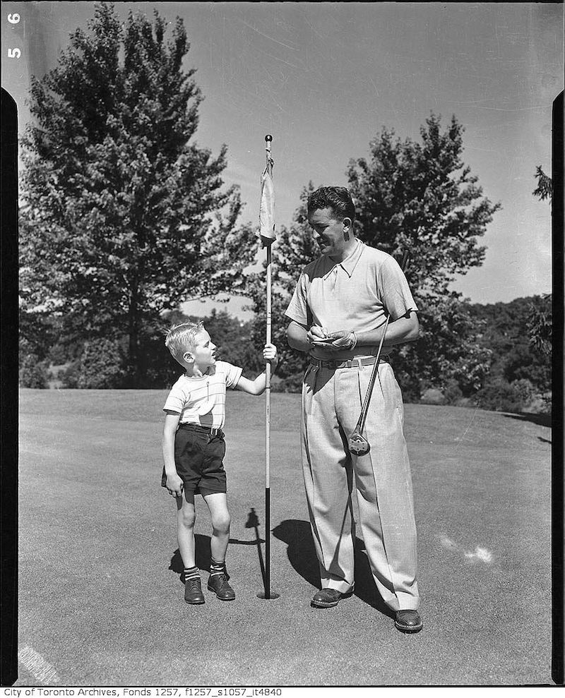 1950? - Golfer with boy