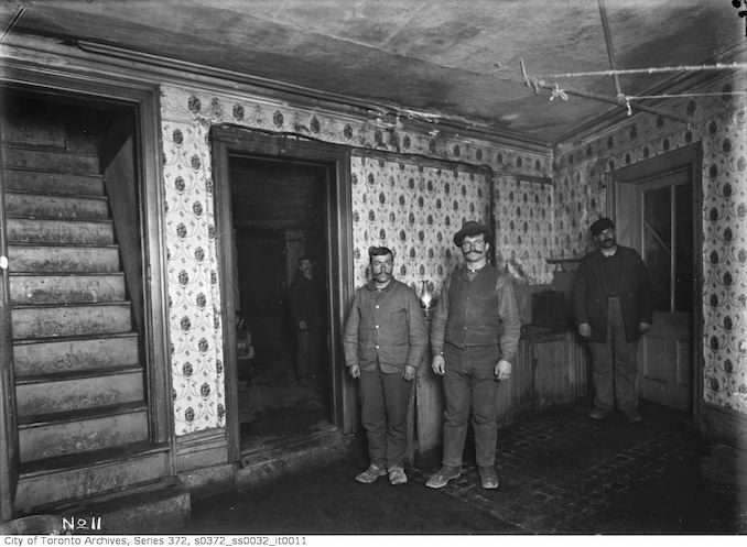 1911 - January 29 - Slum interior, occupied - 318 King Street East
