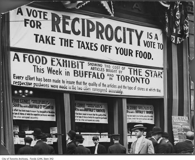 1911 - Signs in window of the Toronto Star building, King Street West
