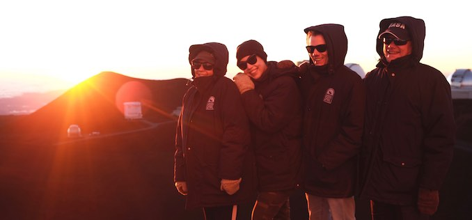 My family and I at the Mauna Kea observatory this past Christmas on the Big Island of Hawaii. It's 14,000 feet above sea level and extremely windy, so the jackets are absolutely necessary.