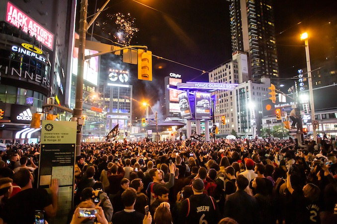 Raptors fans celebrate win at Yonge and Dundas Square. Photo by Joel Levy