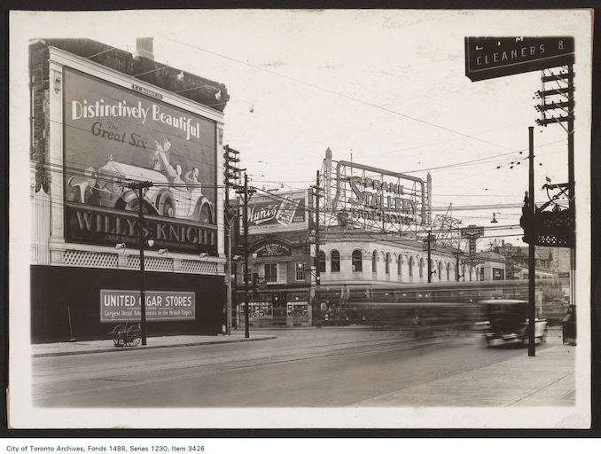 1929 - south-east and south-west corners of Yonge and Bloor streets. View is looking south-west. Willys-Knight Great Six Motor Cars - Hunt's Limited Candies and Ice Cream - Frank Stollery Store for Men