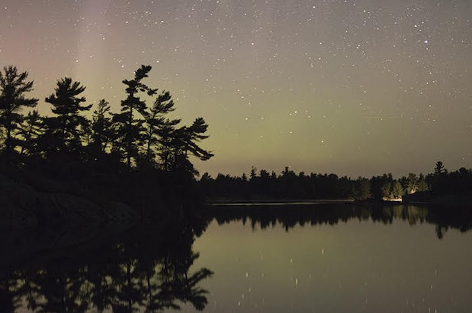 David Brown - My family has a cottage on Georgian Bay.  The original cottage was built by my great grandfather, my son is the 5th generation coming here.  It is a beautiful and rugged place that has shaped who I am and how I see the world.  This photo was take this August and shows the Northern lights shinning above the white pine horizon.