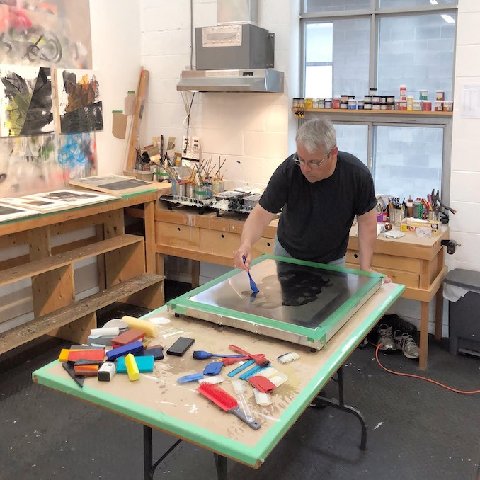 Here I am making an Encaustic Monotype.  The coloured beeswax paint is melted on a heated surface.  The molten wax is then manipulated with silicone tools to create lines and textures.  Once the composition is complete absorbent paper is placed on top of the plate and the image is transferred to the paper.