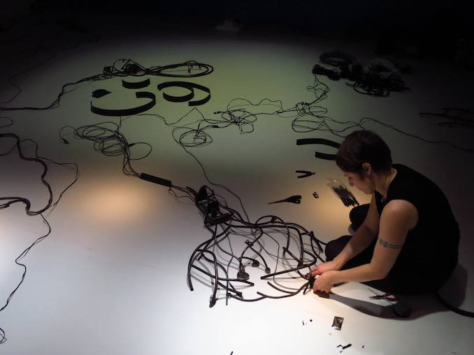 Jane Tingley - in Sao Paolo, Brazil for the exhibition of Peripheral Response in the exhibition Despertar/Eveil/Alive (2014)– installing the work