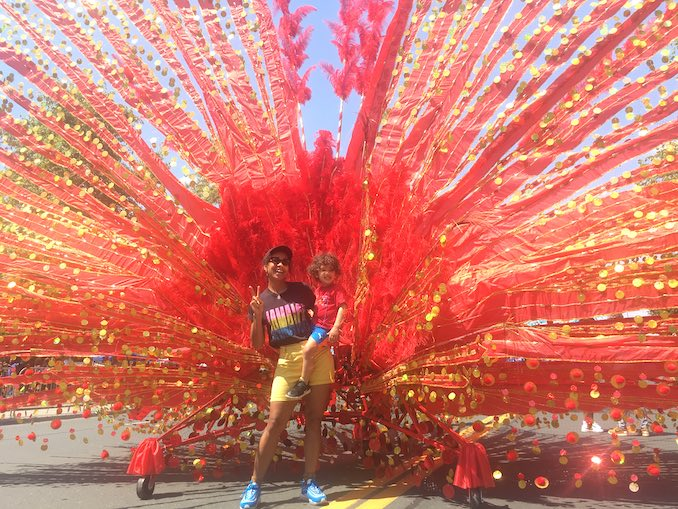 This is me with a giant Caribana costume with my son Brixton.