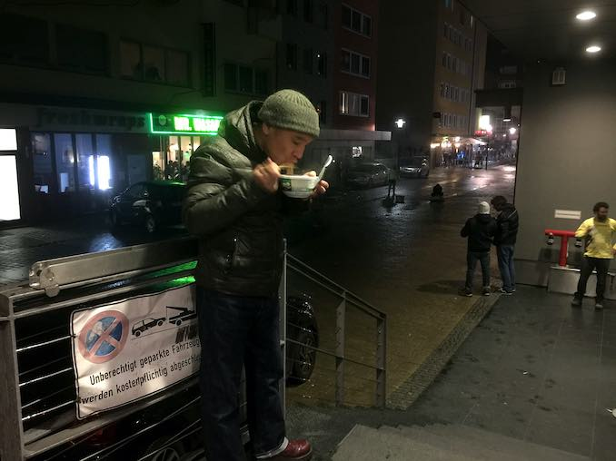"""It's a photo of New Year's eve. Eating """"Toshi-koshi-Soba"""" noodle at the loading dock in Hamburg. This noodle is special for Japanese."""
