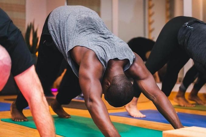 Practicing hatha yoga at Culture Athletics in Toronto.