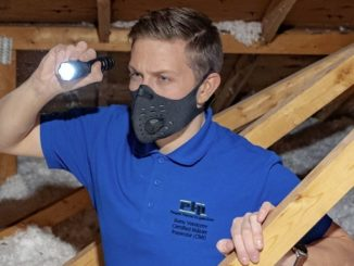 power Home Inspections - Boris inspects an attic in liberty village