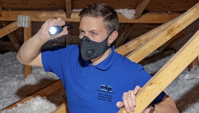 Boris Vorobyov of Power Home Inspections - Boris inspects an attic in liberty village