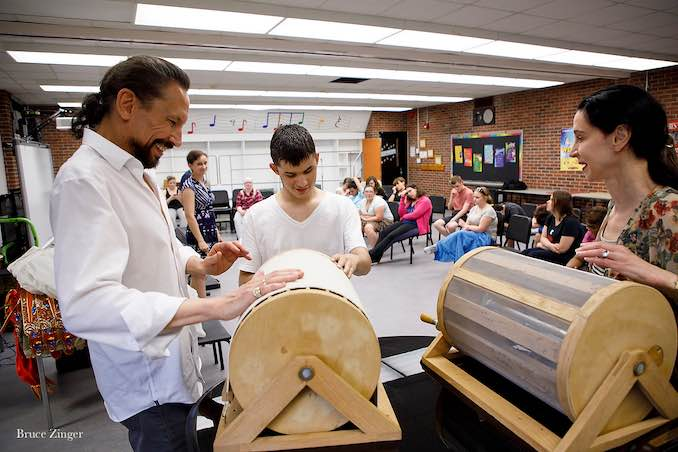 Co-Artistic Director Marshall Pynkoski demonstrates a wind machine to a student from the Blind and Partially-Sighted community in Opera Atelier's Making of an Opera program.