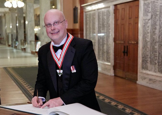The boy cleans up nice! Here I am signing the official registry at Queen's Park after being inducted into the Order of Ontario.