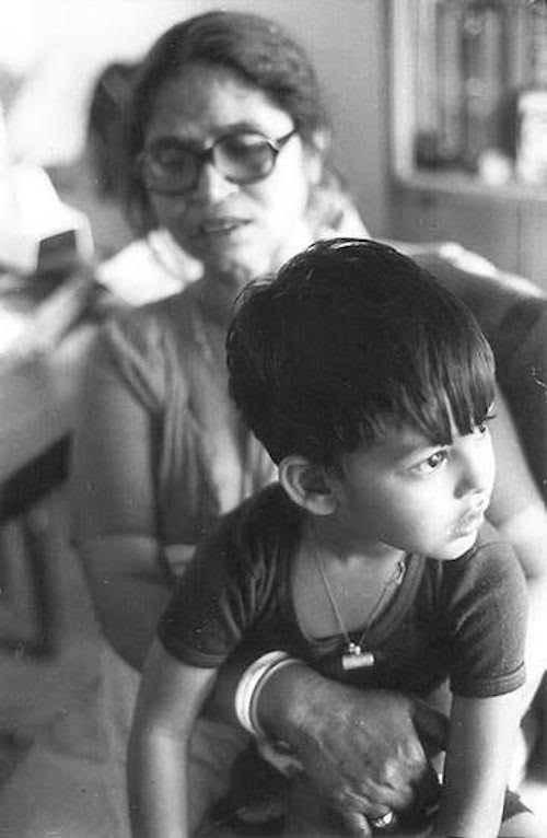 Vikram listening to stories, sitting on his Grandmother's lap - New Delhi, India