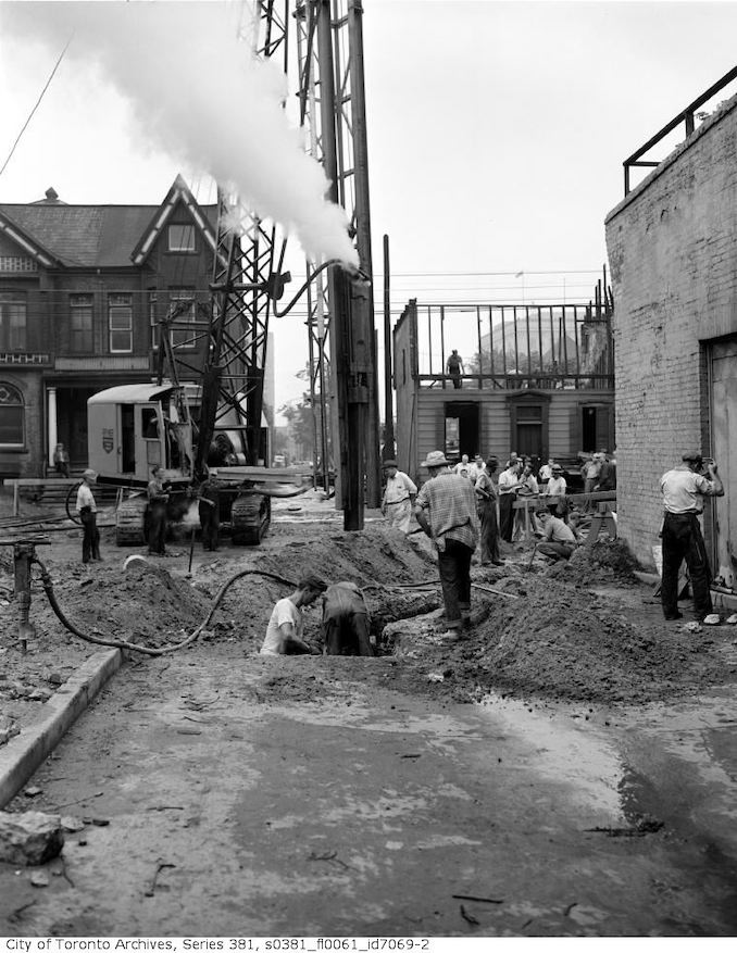 1950 - July 14 - Raynor construction driving first pile in new section of subway, Maitland Street