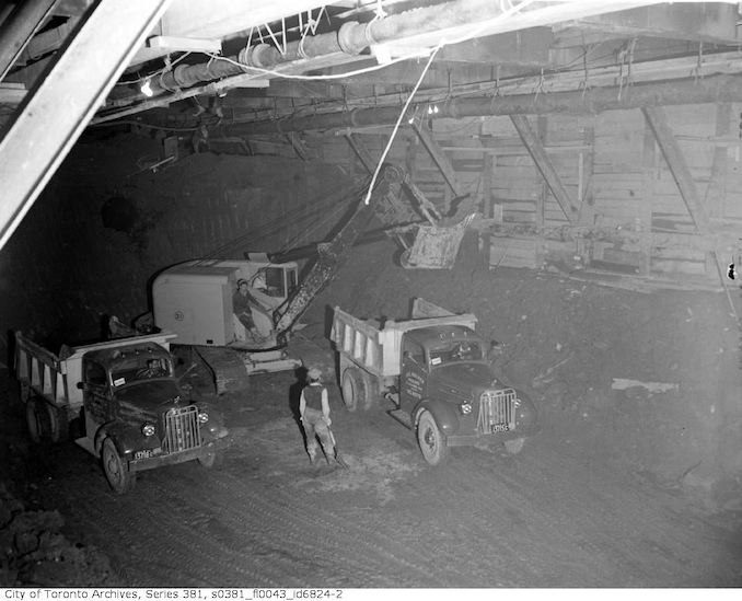 1950-May 2-Men and trucks underground, Colborne Street