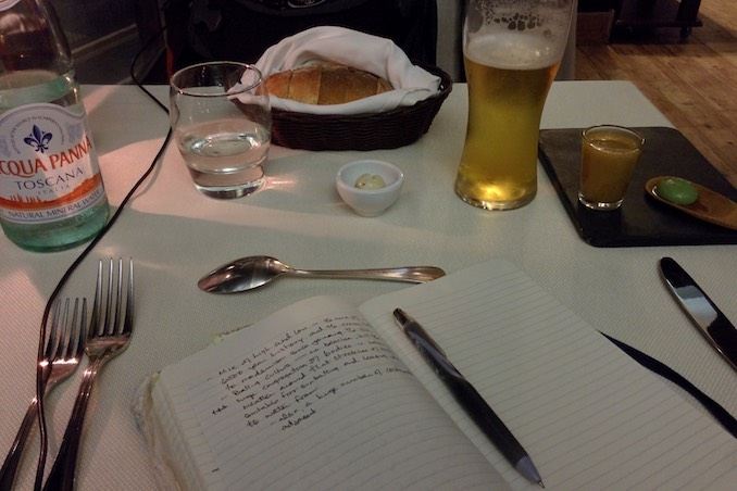 My usual view at a restaurant. If I'm not dining with someone, then I'm sharing the table with my notebook.