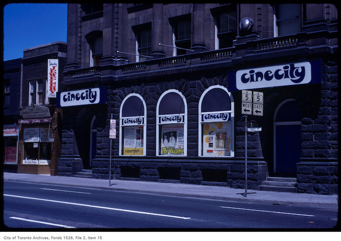 1970 - View of side window display of Cinecity at Yonge and Charles Street East