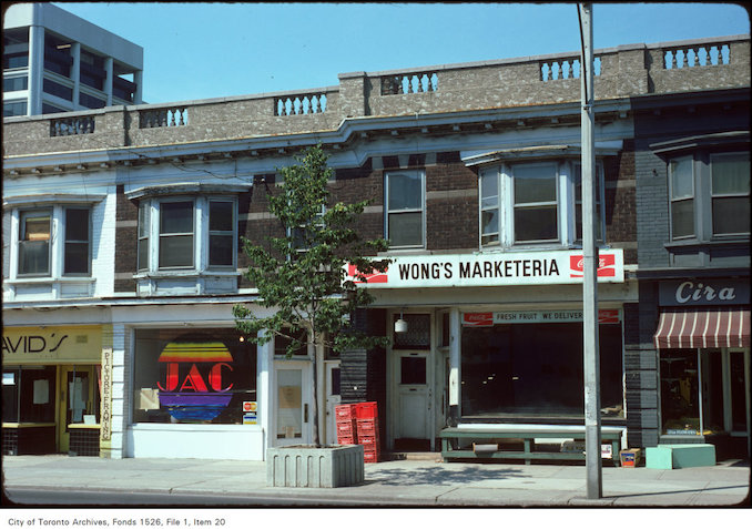 1974 - View of storefronts on the west side of Yonge Street, between Heath and Delisle Avenue