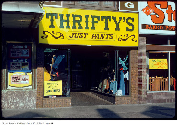 1975 - View of Thrifty's store front and window display on west side of Yonge Street, south of Bloor Street