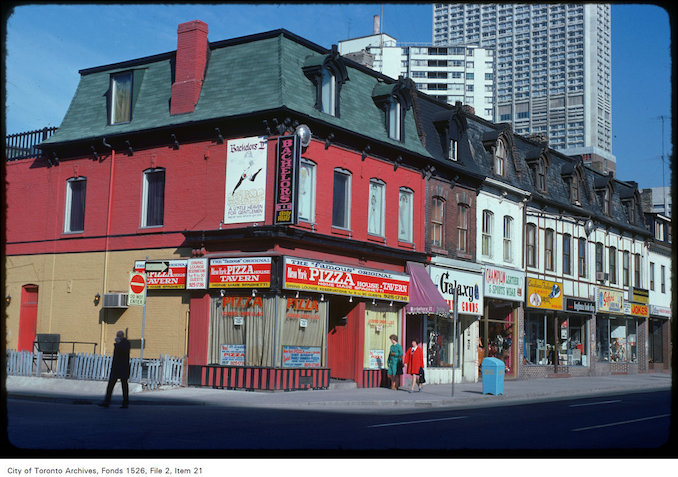 1975 - View of pizza place on the west side of Yonge Street, just north of Wellesley