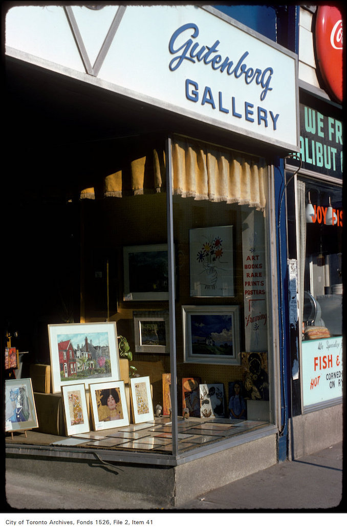 1975 - View of the Gutenberg gallery store window display on the west side of Yonge Street, north of Wellesley