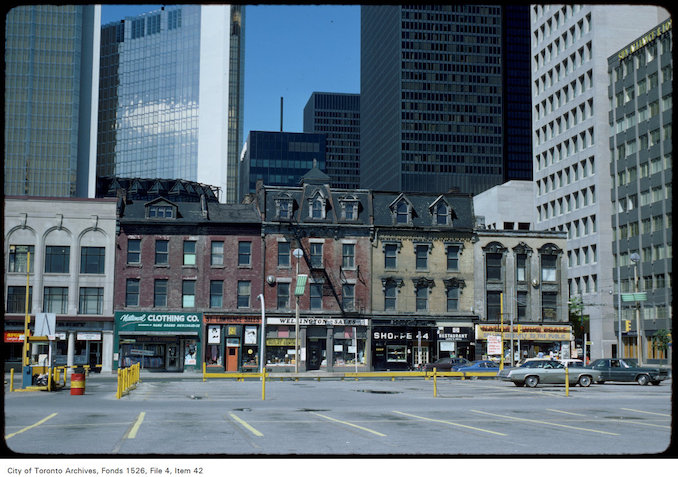 1977 - View of shops on the west side of Yonge Street south of Wellington