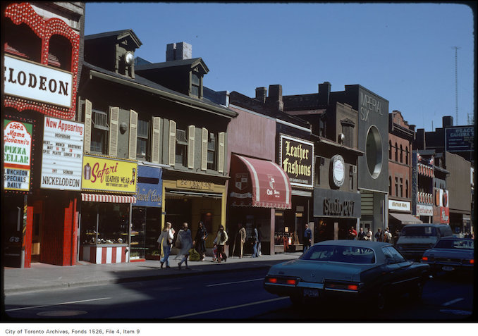 1977 - View of stores on the east side of Yonge Street, south of Dundas Street