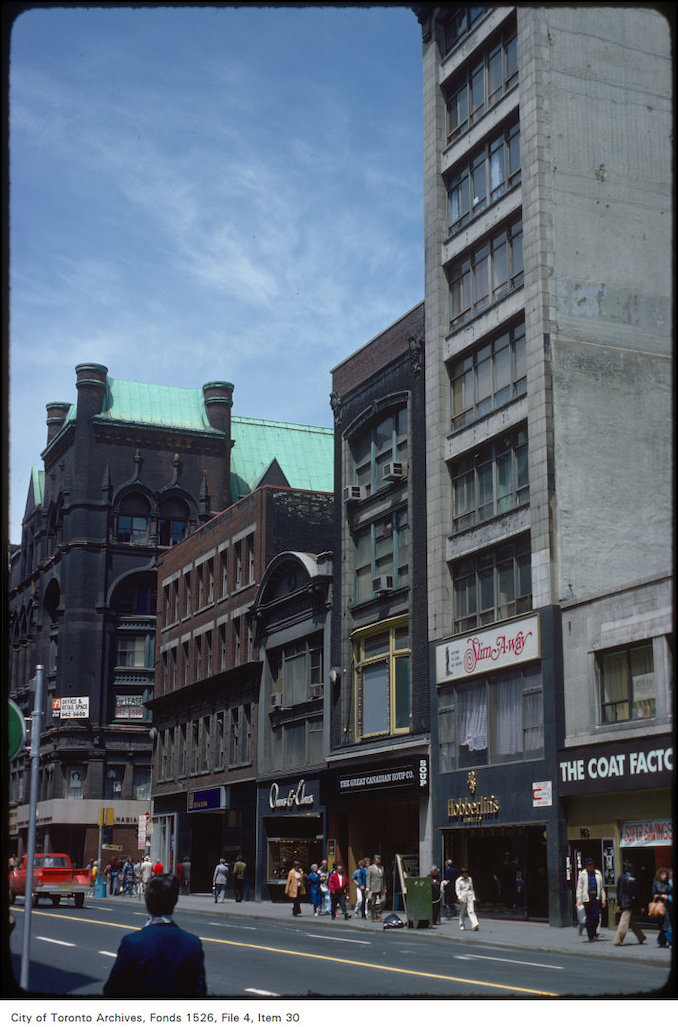 1977 - View of stores on the east side of Yonge Street, south of Richmond Street