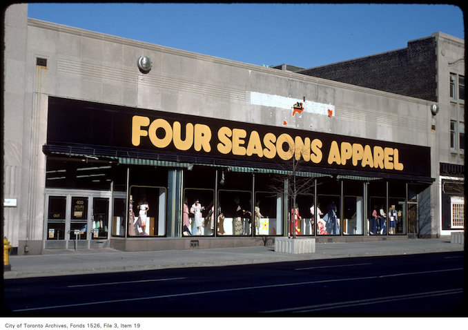 "1977 - View of the store ""Four Seasons Apparel"" on west side of Yonge Street, north of Gerrard"