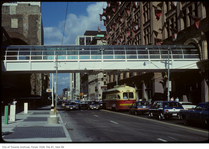 1979 - View of pedestrian walkway, Simpson's and traffic at Yonge and Queen Street