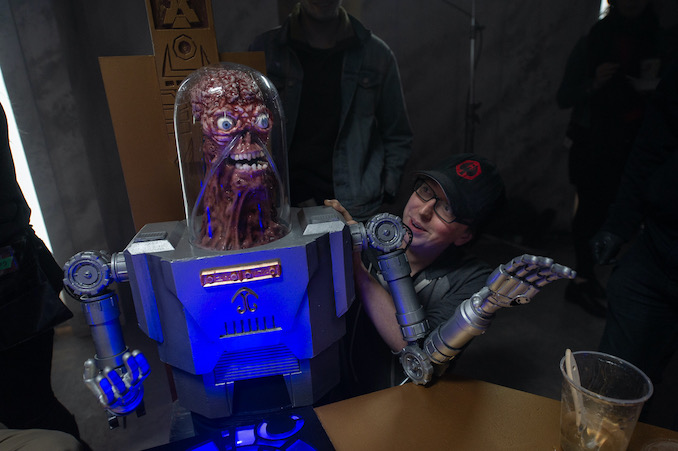 """On set testing out the Tube-Man puppet made by Chris Nash for """"PG: Psycho Goreman""""."""