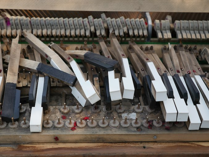 Photo of an abandoned upright piano left on the street taken during one of my neighbourhood walks.